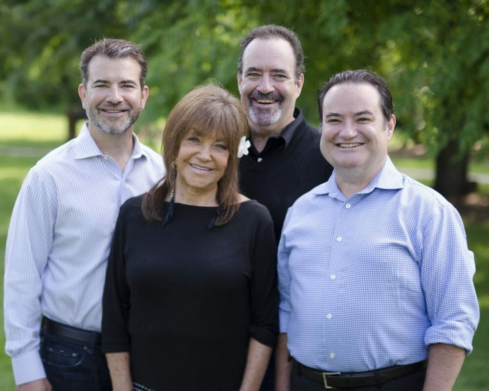 Jeff Miller with his mother and brothers